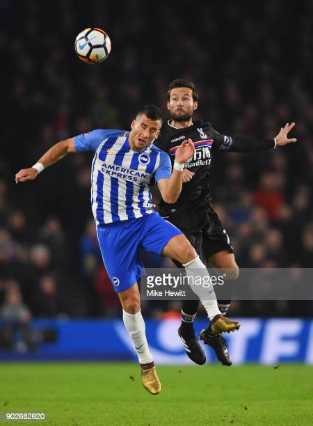 Tomer Hemed of Brighton and Hove Albion and Yohan Cabaye of Crystal Palace jump for the ball during The Emirates FA Cup Third Round match between...