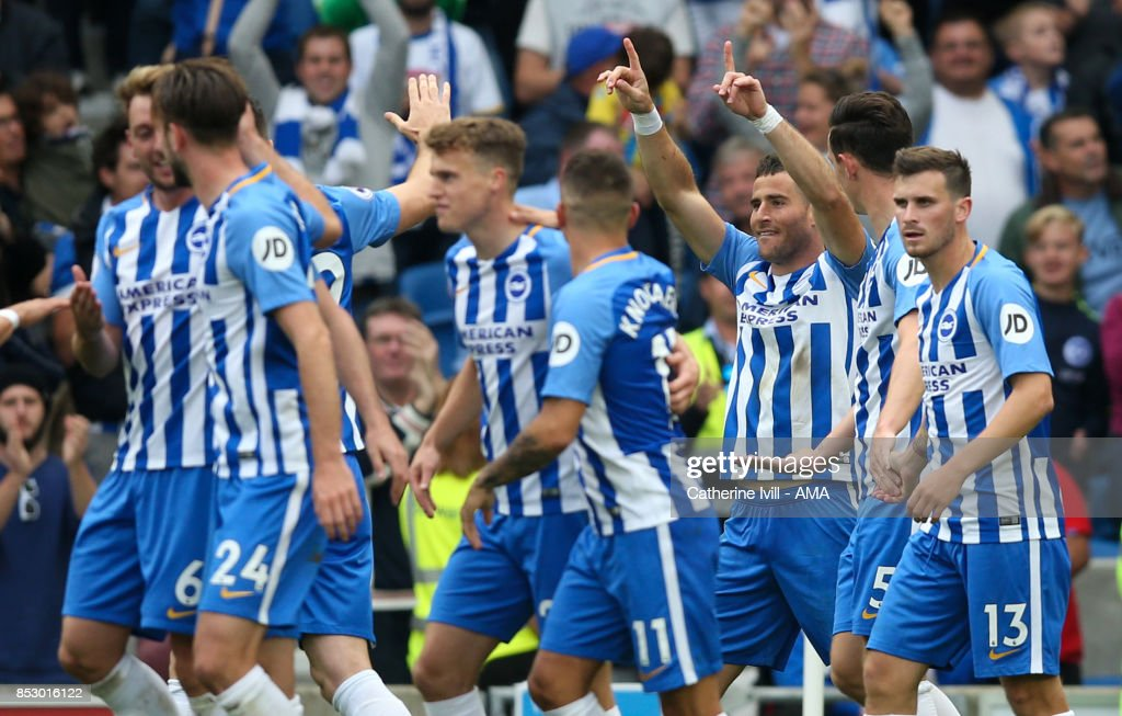 Tomer Hemed (3rd R) of Brighton and Hove Albion celebrates after he scores the opening goal during the Premier League match between Brighton and Hove Albion and Newcastle United at Amex Stadium on September 24, 2017 in Brighton, England.