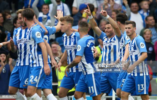 Tomer Hemed of Brighton and Hove Albion celebrates after he scores the opening goal during the Premier League match between Brighton and Hove Albion...
