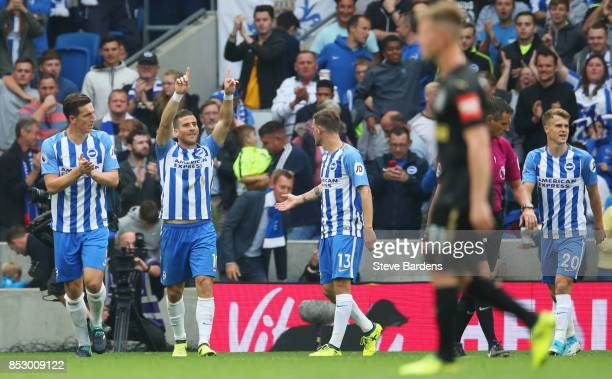 Tomer Hemed of Brighton and Hove Albion celebrates as he scores their first goal during the Premier League match between Brighton and Hove Albion and...