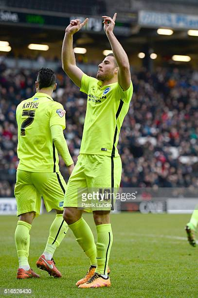 Tomer Hemed of Brighton and Hove Albion celebrates scoring the second goal during the Sky Bet Championship match between Milton Keynes Dons and...