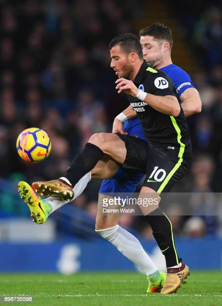 Tomer Hemed of Brighton and Hove Albion holds off Gary Cahill of Chelsea during the Premier League match between Chelsea and Brighton and Hove Albion...