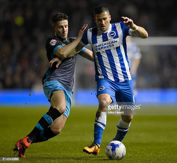 Tomer Hemed of Brighton and Hove Albion is challenged by Sam Hutchinson of Sheffield Wednesday during the Sky Bet Championship match between Brighton...