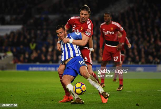 Tomer Hemed of Brighton and Hove Albion is challenged by Sebastian Prodl of Watford during the Premier League match between Brighton and Hove Albion...