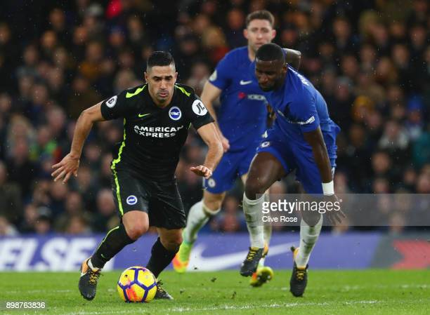 Tomer Hemed of Brighton and Hove Albion is chased by Antonio Rudiger of Chelsea during the Premier League match between Chelsea and Brighton and Hove...