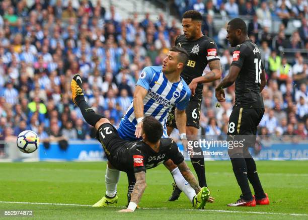 Tomer Hemed of Brighton and Hove Albion is marshalled by Joselu Jamaal Lascelles and Chancel Mbemba of Newcastle United during the Premier League...