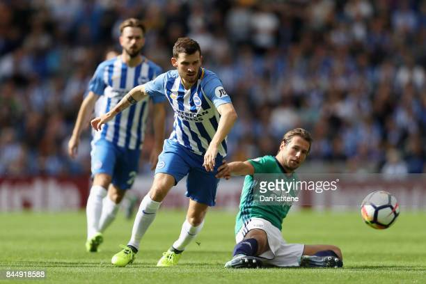 Tomer Hemed of Brighton and Hove Albion is tackled by Grzegorz Krychowiak of West Bromwich Albion during the Premier League match between Brighton...