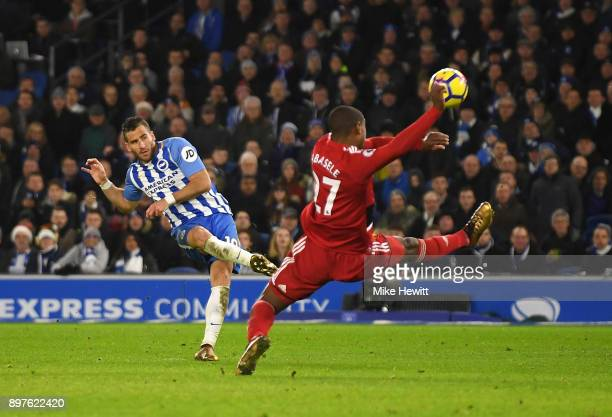 Tomer Hemed of Brighton and Hove Albion shoots as Christian Kabasele of Watford attempts to block during the Premier League match between Brighton...
