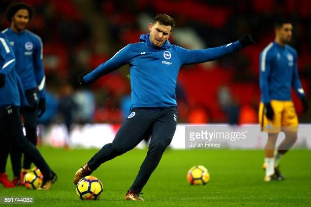 Tomer Hemed of Brighton and Hove Albion shoots as he warms up prior to the Premier League match between Tottenham Hotspur and Brighton and Hove...