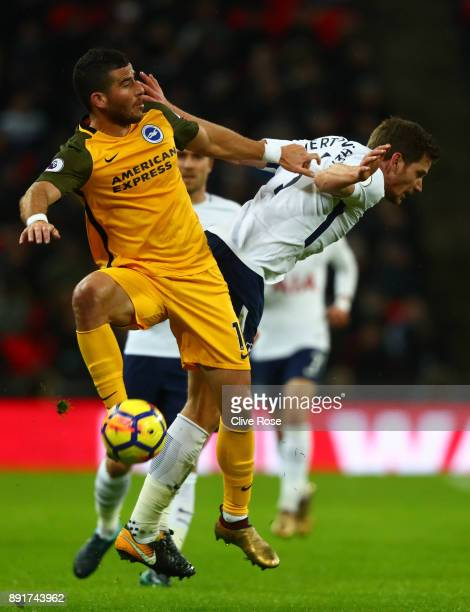 Tomer Hemed of Brighton and Hove Albion wins a header over Jan Vertonghen of Tottenham Hotspur during the Premier League match between Tottenham...