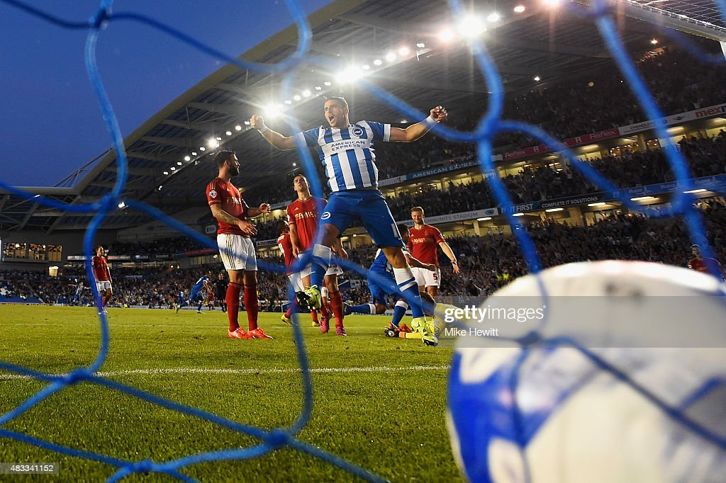 Tomer Hemed of Brighton celebrates the only goal of the game scored by team mate Kazenga LuaLua (obscured) during the Sky Bet Championship match between Brighton & Hove Albion and Nottingham Forest at Amex Stadium on August 7, 2015 in Brighton, England.