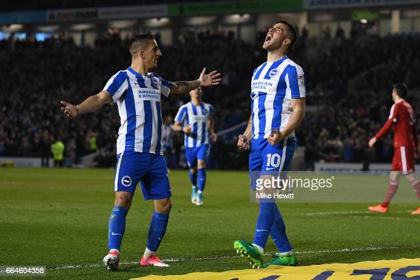 Tomer Hemed of Brighton celebrates with team mate Anthony Knockaert after scoring during the Sky Bet Championship match between Brighton Hove Albion...