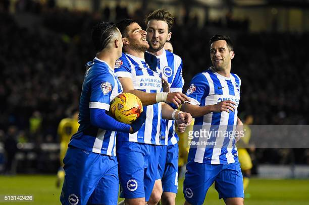 Tomer Hemed of Brighton Hove Albion celebrates with team mates after scoring from the penalty spot during the Sky Bet Championship match between...