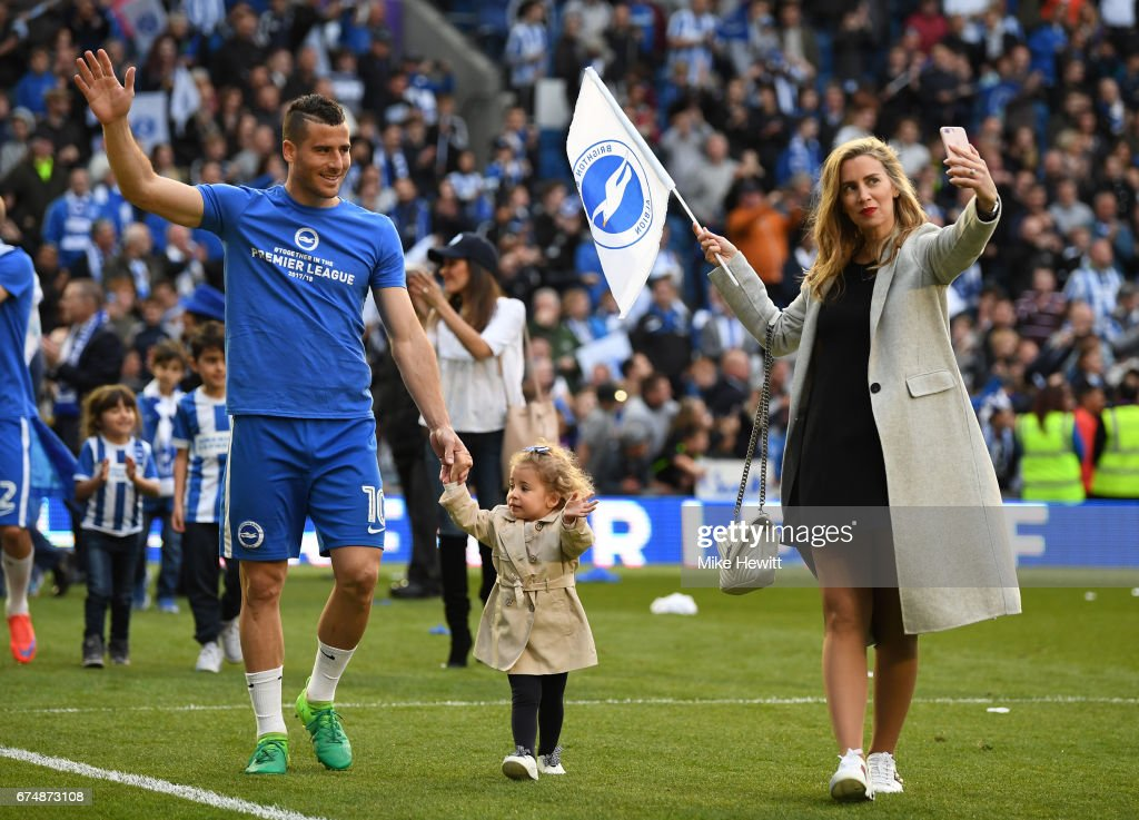 Tomer Hemed of Brighton takes part in a lap of honour with his family after the Sky Bet Championship match between Brighton & Hove Albion and Bristol City at Amex Stadium on April 29, 2017 in Brighton, England.