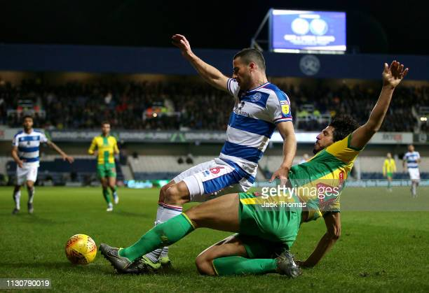 Tomer Hemed of QPR is challenged by Ahmed ElSayed Hegazi of West Bromwich Albion during the Sky Bet Championship match between Queens Park Rangers...