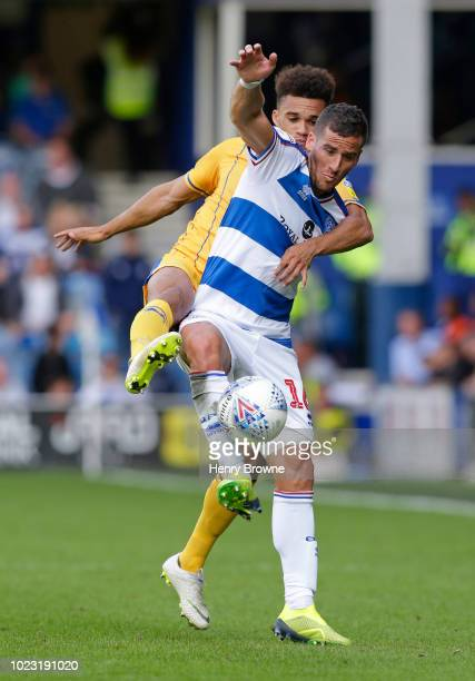 Tomer Hemed of Queens Park Rangers and Antonee Robinson of Wigan Athletic during the Sky Bet Championship match between Queens Park Rangers and Wigan...