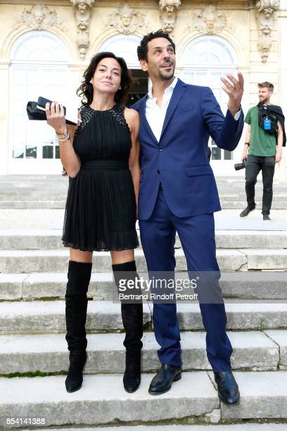 Tomer Sisley and Sandra Zeitoun attend the Christian Dior show as part of the Paris Fashion Week Womenswear Spring/Summer 2018 on September 26 2017...