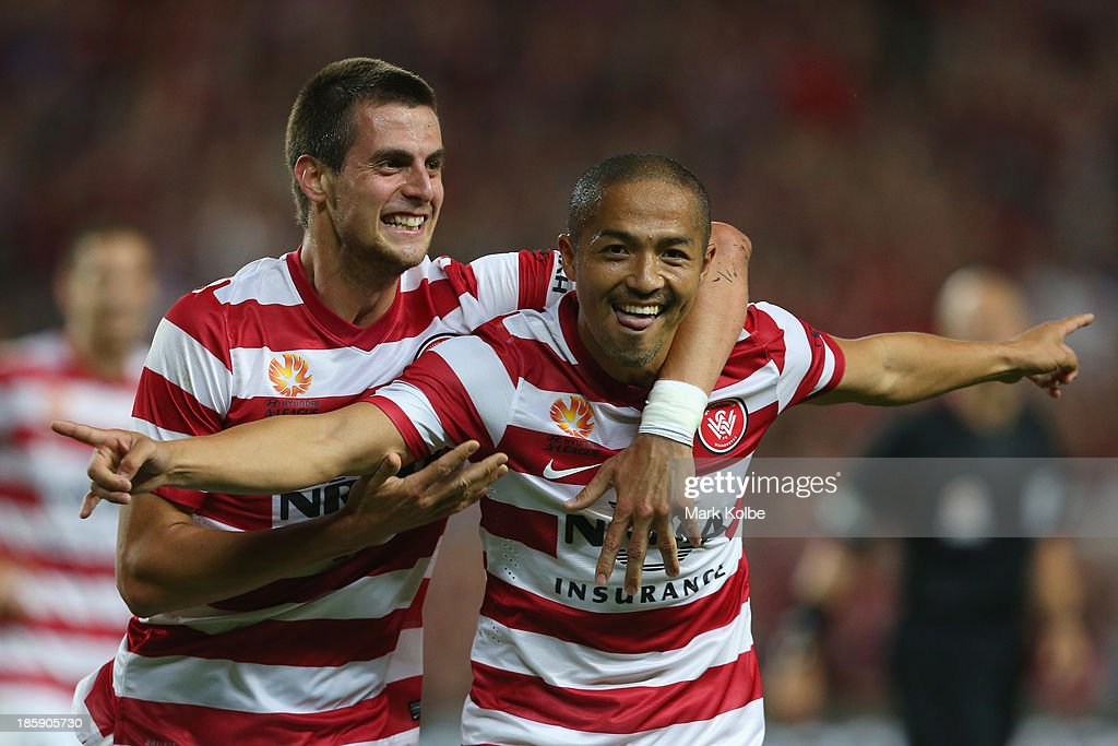 Tomi Juric and Shinji Ono of the Wanderers celebrate after Ono scored a goal during the round three A-League match between Sydney FC and the Western Sydney Wanderers at Allianz Stadium on October 26, 2013 in Sydney, Australia.