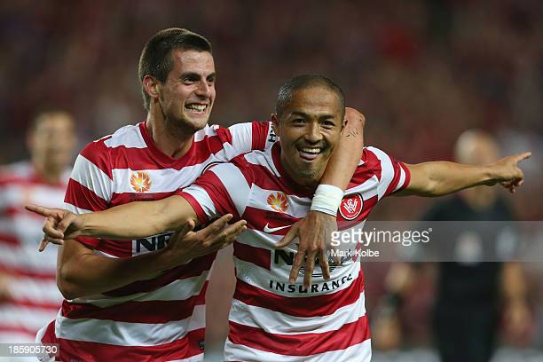 Tomi Juric and Shinji Ono of the Wanderers celebrate after Ono scored a goal during the round three ALeague match between Sydney FC and the Western...