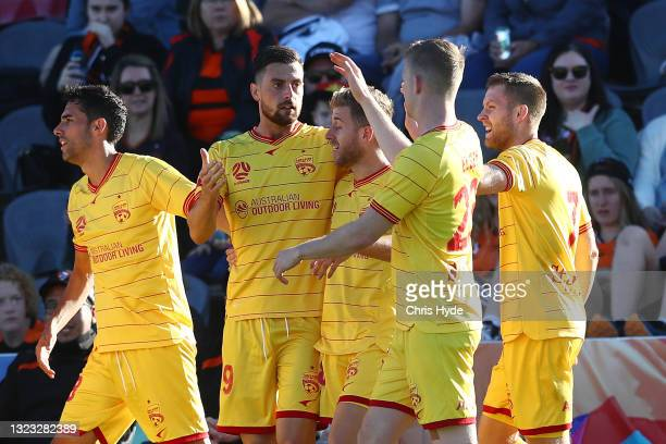 Tomi Juric of Adelaide celebrates a goal during the A-League Elimination Final match between Brisbane Roar and Adelaide United at Moreton Daily...