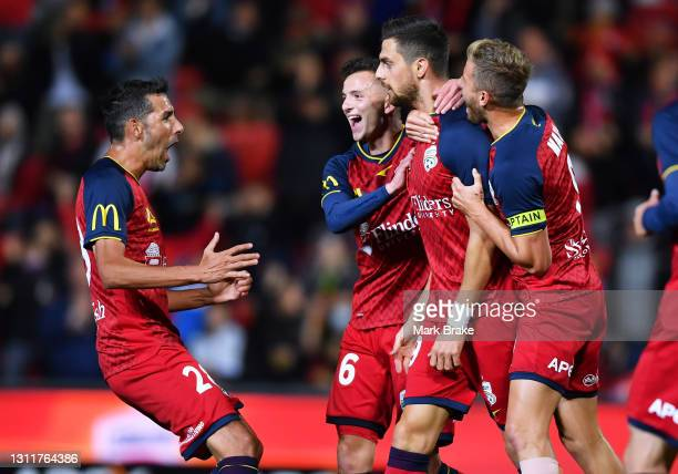 Tomi Juric of Adelaide United celebrates after scoring his teams first goal with Louis D'Arrigo of Adelaide United ,Stefan Mauk of Adelaide United...