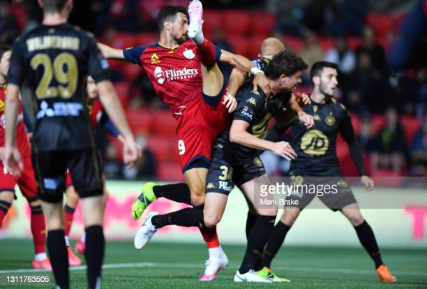 Tomi Juric of Adelaide United scores his teams first goal over Patrick Ziegler of the Wanderers during the A-League match between Adelaide United and...