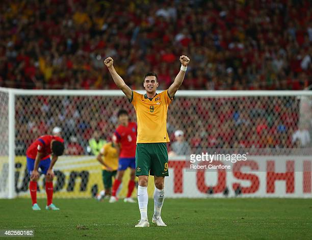 Tomi Juric of Australia celebrates on the final whistle after Australia defeated Korea Republic during the 2015 Asian Cup final match between Korea...