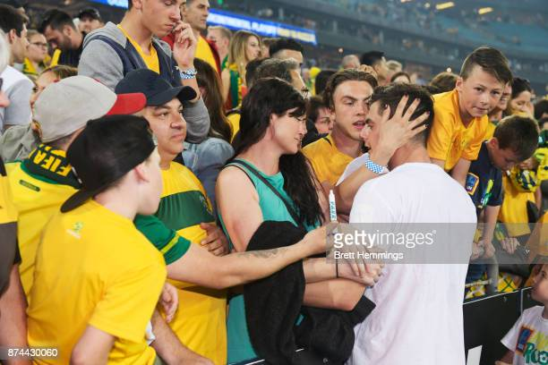 Tomi Juric of Australia celebrates victory with fans during the 2018 FIFA World Cup Qualifiers Leg 2 match between the Australian Socceroos and...