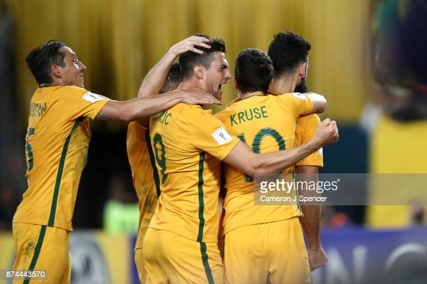 Tomi Juric of Australia congratulates team mate Mile Jedinak of Australia after scoring a penalty during the 2018 FIFA World Cup Qualifiers Leg 2...