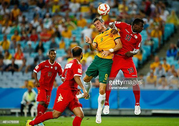 Tomi Juric of Australia fights for a high ball against Abdul Sallam Al Mukhaini of Oman during the 2015 Asian Cup match between Oman and Australia at...