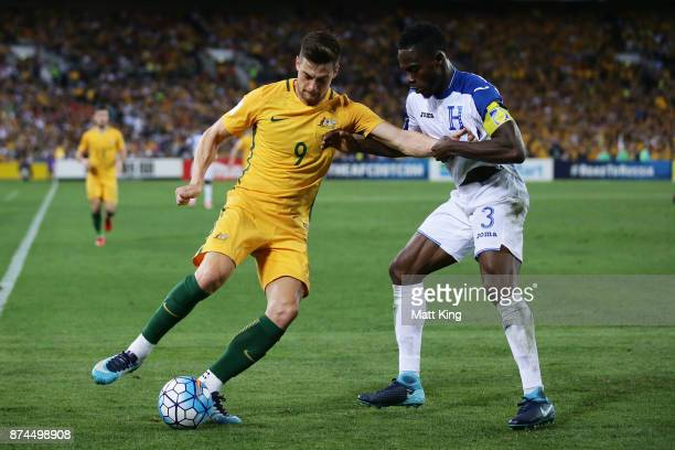 Tomi Juric of Australia is challenged by Maynor Figueroa of Honduras during the 2018 FIFA World Cup Qualifiers Leg 2 match between the Australian...