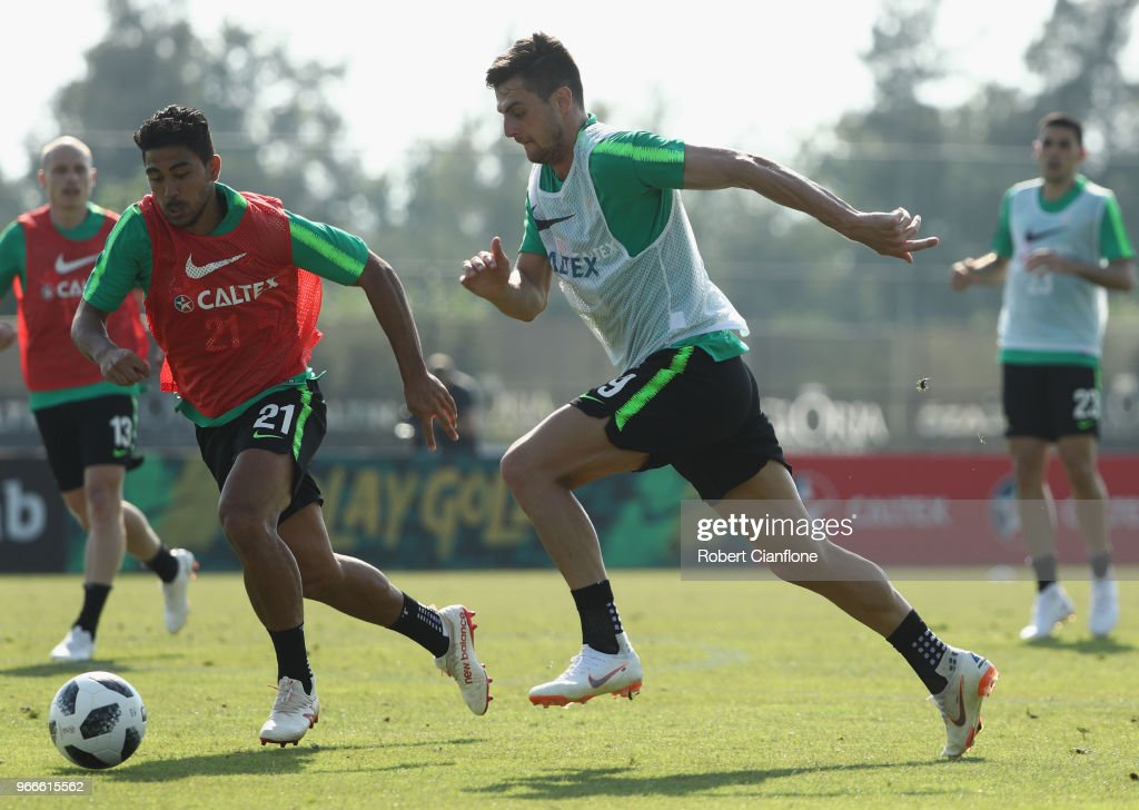 Tomi Juric of Australia is chased by Massimo Luongo of Australia during the Australian Socceroos Training Session at the Gloria Football Club on June 3, 2018 in Antalya, Turkey.