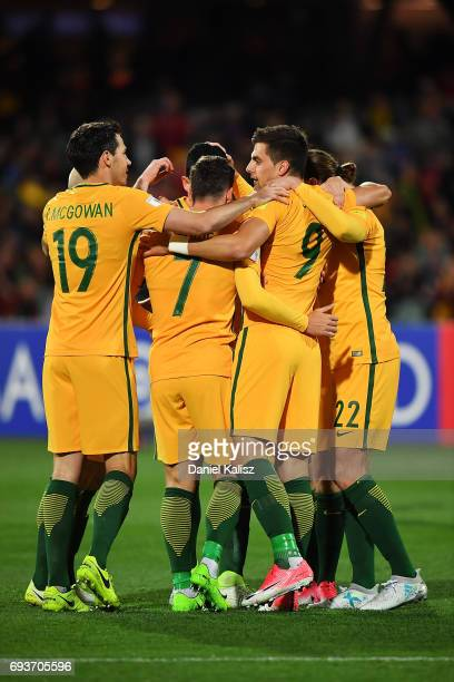Tomi Juric of Australia is congratulated by his team mates after scoring a goal during the 2018 FIFA World Cup Qualifier match between the Australian...