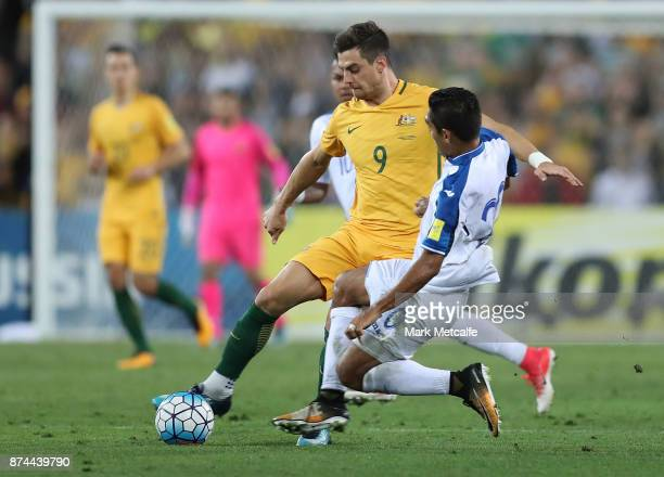 Tomi Juric of Australia is tackled by Jorge Claros of Honduras during the 2018 FIFA World Cup Qualifiers Leg 2 match between the Australian Socceroos...