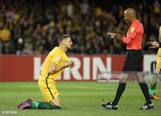 Tomi Juric of Australia pleads with referee Nawaf Shukralla during the 2018 FIFA World Cup Qualifier match between the Australian Socceroos and Japan...