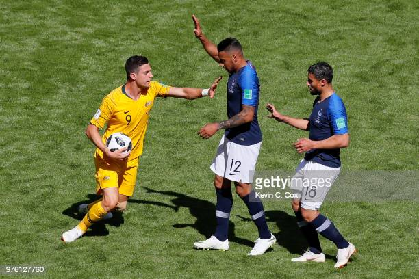 Tomi Juric of Australia reacts to Corentin Tolisso of France as Nabil Fekir of France looks on during the 2018 FIFA World Cup Russia group C match...