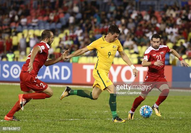 Tomi Juric of Australia runs with the ball during the 2018 FIFA World Cup Asian Playoff match between Syria and the Australia Socceroos at Hang Jebat...
