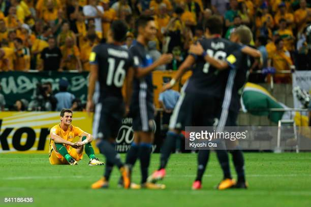 Tomi Juric of Australia shows dejection after his side's 02 defeat in the FIFA World Cup Qualifier match between Japan and Australia at Saitama...