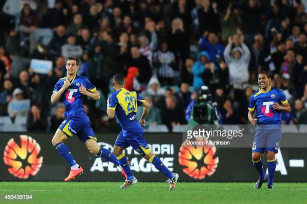 Tomi Juric of the All Stars celebrates his goal during the match between the ALeague All Stars and Juventus at ANZ Stadium on August 10 2014 in...