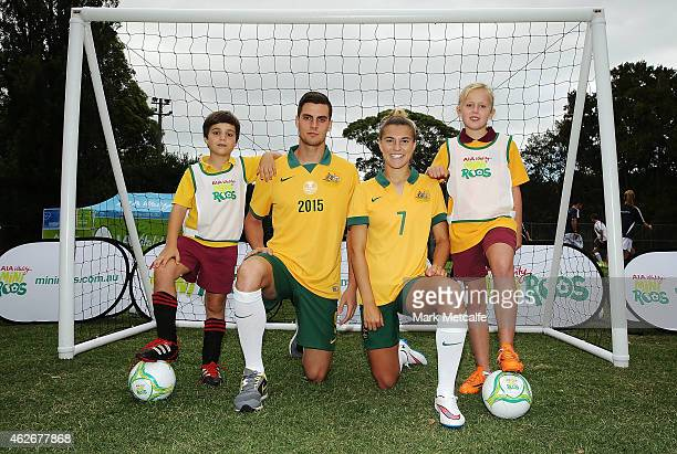 Tomi Juric of the Socceroos and Steph Catley of the Matildas pose with young soccer players at the launch of MiniRoos kids football at Cohen Park...