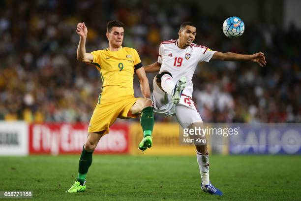 Tomi Juric of the Socceroos competes for the ball against Ismail Ahmed of the United Arab Emirates during the 2018 FIFA World Cup Qualifier match...
