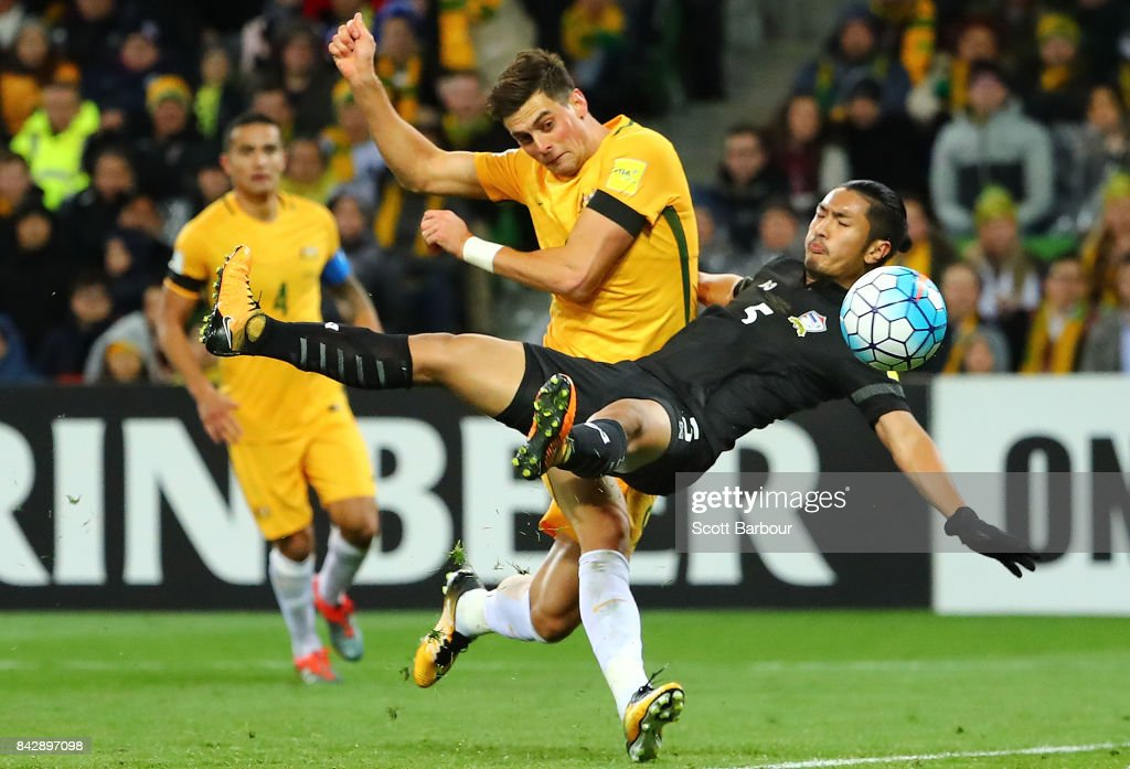 Tomi Juric of the Socceroos has his shot on goal deflected by Adison Promrak of Thailand and past goalkeeper Sinthaweechai Hathairattanakool of Thailand during the 2018 FIFA World Cup Qualifier match between the Australian Socceroos and Thailand at AAMI Park on September 5, 2017 in Melbourne, Australia.
