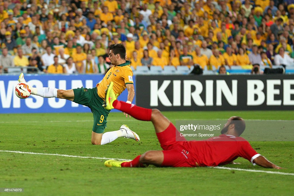 Tomi Juric of the Socceroos scores a goal during the 2015 Asian Cup match between Oman and Australia at ANZ Stadium on January 13, 2015 in Sydney, Australia.