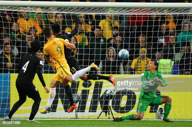 Tomi Juric of the Socceroos scores the first goal past goalkeeper Sinthaweechai Hathairattanakool of Thailand during the 2018 FIFA World Cup...