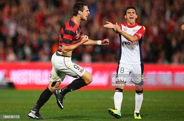 Tomi Juric of the Wanderers celebrates scoring his first goal as Isaias of Adelaide protests to referee Jarred Gillett during the round four ALeague...