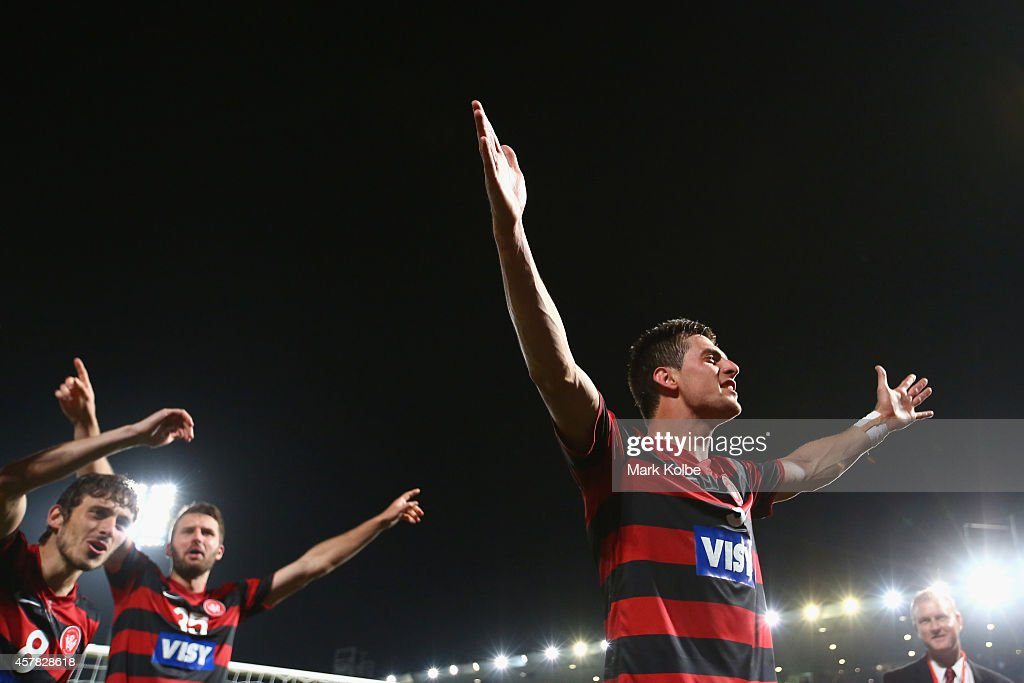 Tomi Juric of the Wanderers celebrates with his team in front of the crowd after victory during the Asian Champions League final match between the Western Sydney Wanderers and Al Hilal at Pirtek Stadium on October 25, 2014 in Sydney, Australia.
