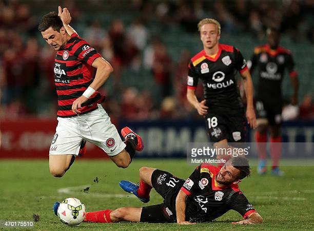 Tomi Juric of the Wanderers is tackled by Cameron Watson of United during the round 26 ALeague match between the Western Sydney Wanderers and...