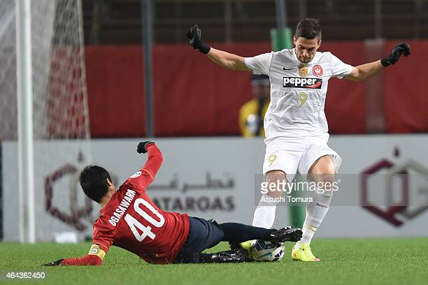 Tomi Juric of Western Sydney Wanderers FC is tackled by Mitsuo Ogasawara of Kashima Antlers during the AFC Champions League Group H match between...