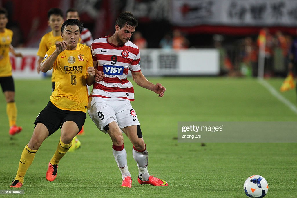 Tomi Juric of Western Sydney Wanderers in action with Feng Xiaoting of Guangzhou Evergrande during the Asian Champions League Quarter Final match between the Western Sydney Wanderers and Guangzhou Evergrande at Tianhe Sports Center on August 27, 2014 in Guangzhou, China.