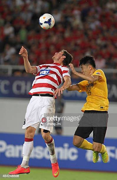 Tomi Juric of Western Sydney Wanderers in action with Liu Jian of Guangzhou Evergrande during the Asian Champions League Quarter Final match between...